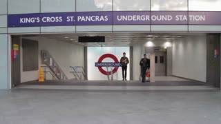 LONDON, UK - JUNE 28: Tourists, shoppers and commuters enter Kings Cross St Pancras Underground Station