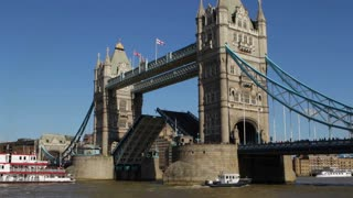 LONDON, UK - MARCH 25, 2016: A paddle steamer passes through Tower Bridge's raised drawbridge