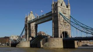 LONDON, UK - MARCH 25, 2016: Tower Bridge lifts up its drawbridge