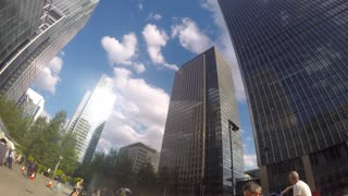 LONDON, UK - MAY 2015: Panning time-lapse clip of commuters as they rush around Canary Wharf against a backdrop of skyscrapers