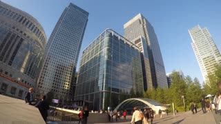 LONDON, UK - MAY 2015: Time-lapse clip of commuters as they rush around Canary Wharf against a backdrop of skyscrapers