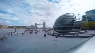 LONDON, UK - MAY 2015: Wide angle view of  City Hall and Tower Bridge with tourists walking