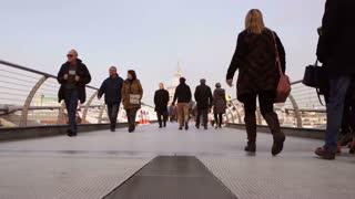 LONDON, UK - NOV 23, 2015: People on Millennium Bridge (wide shot)