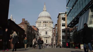 LONDON, UK - NOV 23, 2015: St Paul's Cathedral and tourists (mid shot)