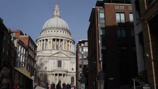 LONDON, UK - NOV 23, 2015: St Paul's Cathedral and tourists