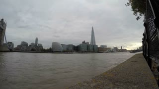 LONDON, UK - OCTOBER 2015: Panning time lapse clip from the Shard to Tower Bridge with boats traveling on the Thames