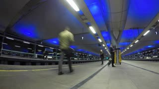 LONDON, UK - OCTOBER 2015: Panning time lapse clip of of commuters at Blackfriars station waiting for First Capital Connect train to arrive.