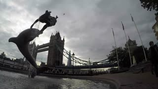 LONDON, UK - OCTOBER 2015: Panning time lapse clip of Tower Bridge with statue in foreground