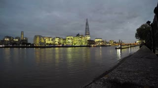 LONDON, UK - OCTOBER 2015: Panning timelapse clipped of the lit-up London skyline on the bank of the Thames, from the Shard to Tower Bridge