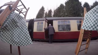 LOUGHBOROUGH, UK - NOVEMBER 21, 2015: Guard closes vintage rail carriage door at Rothley station on the Great Central Railway
