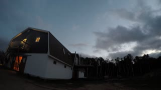Night falls on a Canadian barn in this time-lapse clip as clouds flow past at high speed