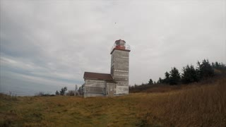 Panning time-lapse from lighthouse to ocean in Canada