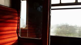PETERBOROUGH, UK - FEBRUARY 18, 2016: Passenger sits in old fashioned coach on the Nene Valley Railway