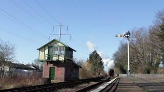 PETERBOROUGH, UK - FEBRUARY 18, 2016: Steam engine arrives at station on Nene Valley Railway