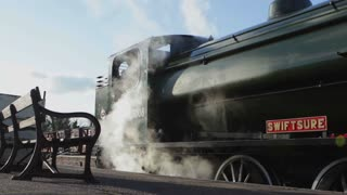 PETERBOROUGH, UK - FEBRUARY 18, 2016: Steam engine by platform on Nene Valley Railway