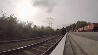 PETERBOROUGH, UK - OCTOBER 9, 2015: Steam engine pulls into Peterborough station on the Nene Valley Railway