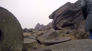 Photographer explores rocky Stanage Edge in the English Peak District