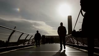 Silhouetted people on Millennium Bridge