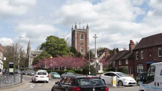 ST ALBANS, UK - APRIL 28, 2016: St Peters Church and traffic