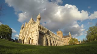 ST ALBANS, UK - APRIL 29, 2016: Time-lapse of clouds and Cathedral in the golden hour