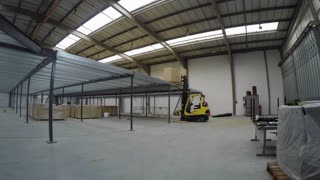 ST ALBANS, UK - MARCH 17, 2016: Time-lapse of construction work in a warehouse to build a mezzanine floor for St Albans Vineyard Church
