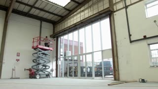 ST ALBANS, UK - MAY 31, 2016: Hydraulic scissor lifting platform rises in a warehouse