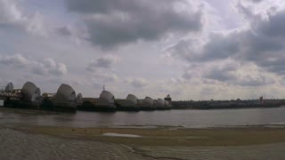 Thames Barrier time-lapse with fast flowing clouds
