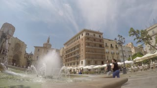 VALENCIA, SPAIN - JULY 2015: Panning timelapse footage of tourists enjoying a sunny square near the Cathedral