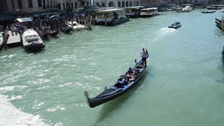 VENICE, ITALY - AUGUST 2012:  Gondola on the Grand canal, filmed from the Rialto bridge