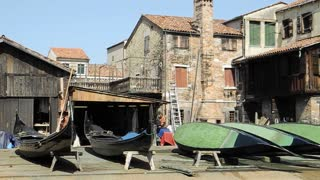 VENICE, ITALY - AUGUST 2012:  Gondolas in dry dock for maintenance (midshot)