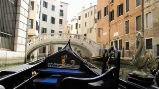 VENICE, ITALY - AUGUST 2012: View from inside gondola as it approaches a bridge