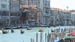 VENICE, ITALY - AUGUST 2012: View of floating gondolas on the Grand canal, filmed from the Rialto bridge