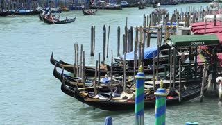 VENICE, ITALY - AUGUST 2012: View of moored gondolas on the Grand canal, filmed from the Rialto bridge