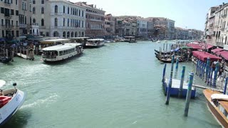 VENICE, ITALY - AUGUST 2012: View  of Vaporreto boat on the Grand canal, filmed from the Rialto bridge
