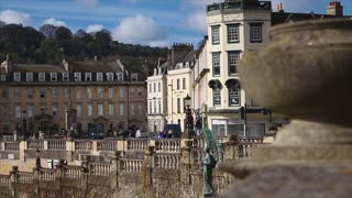 BATH, UK - 10 APRIL 2017:  Pull focus from city buildings to stone wall surrounding the Parade Gardens
