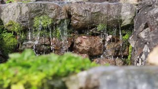 Closeup of water falling from rocks into pool (shot using high shutter speed to reveal water detail)