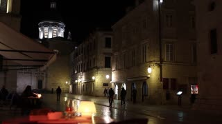 DUBROVNIK, CROATIA - 21 MARCH 2017: View of city streets at night from a restaurant table