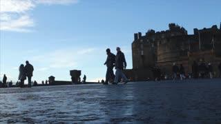 EDINBURGH, UK - 4 DEC, 2017: Tourists walk outside Edinburgh castle on a cold Autumn day