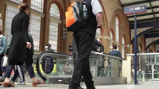 LONDON, UK - 11 MAY 2017:  Commuters use escalator to enter Liverpool Street Station