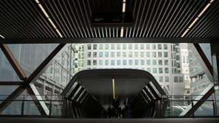 LONDON, UK - 12 APRIL 2017:  Walkway leading from One Canada Square to the Crossrail Station