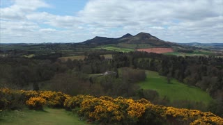 MELROSE, SCOTLAND - 22 APRIL 2017: Tourists enjoy the famous Walter Scott's View of the Eildon hills in Spring