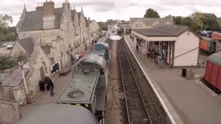 WANSFORD, UK - OCTOBER 9, 2015: Diesel train pulls out of Wansford Station on the Nene Valley Railway as a steam train arrives