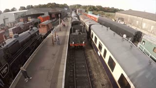 WANSFORD, UK - OCTOBER 9, 2015: Steam engine pulls into Wansford Station on the Nene Valley Railway