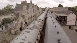 WANSFORD, UK - OCTOBER 9, 2015: Steam engine pulls out of Wansford Station on the Nene Valley Railway
