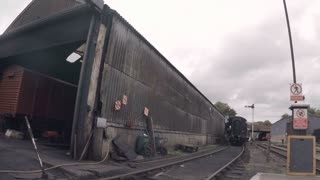 WANSFORD, UK - OCTOBER 9, 2015: Steam engine reverses into Wansford Station on the Nene Valley Railway