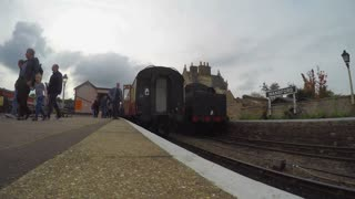 WANSFORD, UK - OCTOBER 9, 2015: Time-lapse of steam engine pulling out of Wansford Station on the Nene Valley Railway