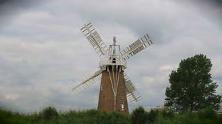 Windmill filmed from a passing canal boat near Norwich, UK