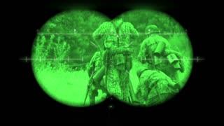 World War 2 battlefield re-enactment viewed through night vision binoculars