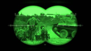 World War 2 German battlefield reenactment viewed through night vision binoculars