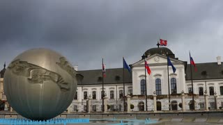 fountain near government building on cloudy sky background, Bratislava, Slovakia